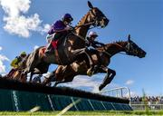 30 July 2018; Easy Game, left, with Ruby Walsh up, jumps the fifth, alongside Galtymore, with Denis Hogan up, on their way to winning the Galmont.com & Galwaybayhotel.com Novice Hurdle during the Galway Races Summer Festival 2018, in Ballybrit, Galway. Photo by Seb Daly/Sportsfile