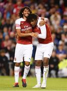 1 August 2018; Alex Iwobi of Arsenal, right, celebrates with Mohamed Elneny and after scoring the winning penalty during the International Champions Cup match between Arsenal and Chelsea at the Aviva Stadium in Dublin. Photo by Sam Barnes/Sportsfile