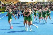 4 August 2018; Ireland players, from left, Chloe Watkins, Anna O'Flanagan and Gillian Pinder, celebrate their victory after a sudden death penalty shootout during the Women's Hockey World Cup Finals semi-final match between Ireland and Spain at the Lee Valley Hockey Centre in QE Olympic Park, London, England. Photo by Craig Mercer/Sportsfile