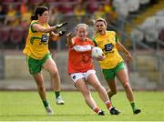 4 August 2018; Marian McGuinness of Armagh in action against Aoife McDonald and Niamh Hegarty of Donegal during the TG4 All-Ireland Ladies Football Senior Championship quarter-final match between Armagh and Donegal at Healy Park in Omagh, Tyrone. Photo by Oliver McVeigh/Sportsfile