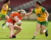 4 August 2018; Lauren McConville of Armagh in action against Therese McCafferty of Donegal during the TG4 All-Ireland Ladies Football Senior Championship quarter-final match between Armagh and Donegal at Healy Park in Omagh, Tyrone. Photo by Oliver McVeigh/Sportsfile