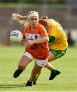 4 August 2018; Lauren McConville of Armagh in action against Deirdre Foley of Donegal during the TG4 All-Ireland Ladies Football Senior Championship quarter-final match between Armagh and Donegal at Healy Park in Omagh, Tyrone. Photo by Oliver McVeigh/Sportsfile