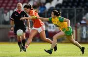4 August 2018; Tiarna Grimes of Armagh in action against Nicole McLaughlin of Donegal during the TG4 All-Ireland Ladies Football Senior Championship quarter-final match between Armagh and Donegal at Healy Park in Omagh, Tyrone. Photo by Oliver McVeigh/Sportsfile