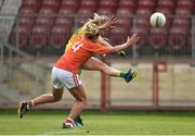4 August 2018; Yvonne Bonner of Donegal scoring a point despite the attention of Sharon Reel of Armagh during the TG4 All-Ireland Ladies Football Senior Championship quarter-final match between Armagh and Donegal at Healy Park in Omagh, Tyrone. Photo by Oliver McVeigh/Sportsfile