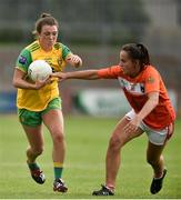 4 August 2018; Eiliish Ward of Donegal  in action against Megan Sheridan of Armagh during the TG4 All-Ireland Ladies Football Senior Championship quarter-final match between Armagh and Donegal at Healy Park in Omagh, Tyrone. Photo by Oliver McVeigh/Sportsfile