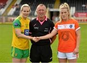 4 August 2018; Referee Brendan Rice with Donegal captain Karen Gutrie, left, and Armagh captain Caoimhe Morgan after the the toss before the TG4 All-Ireland Ladies Football Senior Championship quarter-final match between Armagh and Donegal at Healy Park in Omagh, Tyrone. Photo by Oliver McVeigh/Sportsfile
