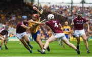 5 August 2018; Peter Duggan of Clare breaks the tackle by Daithí Burke, left, and John Hanbury of Galway on his way to scoring his side's second goal during the GAA Hurling All-Ireland Senior Championship semi-final replay between Galway and Clare at Semple Stadium in Thurles, Co Tipperary. Photo by Ramsey Cardy/Sportsfile