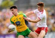 5 August 2018; Michael Langan of Donegal in action against Cathal McShane of Tyrone during the GAA Football All-Ireland Senior Championship Quarter-Final Group 2 Phase 3 match between Tyrone and Donegal at MacCumhaill Park in Ballybofey, Co Donegal. Photo by Stephen McCarthy/Sportsfile