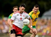 5 August 2018; Mattie Donnelly of Tyrone in action against Leo McLoone of Donegal during the GAA Football All-Ireland Senior Championship Quarter-Final Group 2 Phase 3 match between Tyrone and Donegal at MacCumhaill Park in Ballybofey, Co Donegal. Photo by Philip Fitzpatrick/Sportsfile