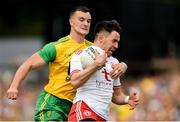 5 August 2018; Mattie Donnelly of Tyrone in action against Leo McLoone of Donegal during the GAA Football All-Ireland Senior Championship Quarter-Final Group 2 Phase 3 match between Tyrone and Donegal at MacCumhaill Park in Ballybofey, Co Donegal.Photo by Philip Fitzpatrick/Sportsfile
