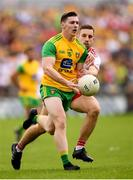 5 August 2018; Jamie Brennan of Donegal in action against Niall Sludden of Tyrone during the GAA Football All-Ireland Senior Championship Quarter-Final Group 2 Phase 3 match between Tyrone and Donegal at MacCumhaill Park in Ballybofey, Co Donegal. Photo by Stephen McCarthy/Sportsfile