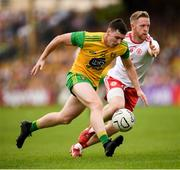 5 August 2018; Jamie Brennan of Donegal in action against Frank Burns of Tyrone during the GAA Football All-Ireland Senior Championship Quarter-Final Group 2 Phase 3 match between Tyrone and Donegal at MacCumhaill Park in Ballybofey, Co Donegal. Photo by Stephen McCarthy/Sportsfile