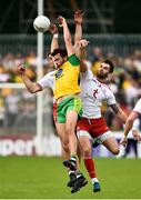 5 August 2018; Odhran MacNiallais of Donegal in action against Niall Sludden and Ronan McNamee of Tyrone during the GAA Football All-Ireland Senior Championship Quarter-Final Group 2 Phase 3 match between Tyrone and Donegal at MacCumhaill Park in Ballybofey, Co Donegal. Photo by Oliver McVeigh/Sportsfile