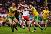 5 August 2018; Matthew Donnelly of Tyrone  in action against Hugh McFadden and Eoghan Bán Gallagher of Donegal during the GAA Football All-Ireland Senior Championship Quarter-Final Group 2 Phase 3 match between Tyrone and Donegal at MacCumhaill Park in Ballybofey, Co Donegal. Photo by Oliver McVeigh/Sportsfile