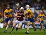 5 August 2018; Joe Canning of Galway is tackled by Conor Cleary of Clare, supported by Jamie Shanahan, during the GAA Hurling All-Ireland Senior Championship semi-final replay match between Galway and Clare at Semple Stadium in Thurles, Co Tipperary. Photo by Ray McManus/Sportsfile