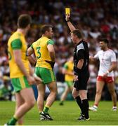 5 August 2018; Referee Joe McQuillan issues Neil McGee of Donegal with a yellow card during the GAA Football All-Ireland Senior Championship Quarter-Final Group 2 Phase 3 match between Tyrone and Donegal at MacCumhaill Park in Ballybofey, Co Donegal. Photo by Oliver McVeigh/Sportsfile