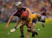 5 August 2018; John Conlon of Clare is tackled by Daithí Burke of Galway during the GAA Hurling All-Ireland Senior Championship semi-final replay match between Galway and Clare at Semple Stadium in Thurles, Co Tipperary. Photo by Ray McManus/Sportsfile