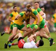 5 August 2018; Mattie Donnelly of Tyrone in action against Donegal players, from left, Michael Murphy, Stephen McMenamin and Ciaran Thompson during the GAA Football All-Ireland Senior Championship Quarter-Final Group 2 Phase 3 match between Tyrone and Donegal at MacCumhaill Park in Ballybofey, Co Donegal. Photo by Stephen McCarthy/Sportsfile