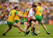 5 August 2018; Mattie Donnelly of Tyrone in action against Donegal players, from left, Michael Murphy, Ciaran Thompson and Stephen McMenamin during the GAA Football All-Ireland Senior Championship Quarter-Final Group 2 Phase 3 match between Tyrone and Donegal at MacCumhaill Park in Ballybofey, Co Donegal. Photo by Stephen McCarthy/Sportsfile