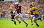 5 August 2018; Joe Canning of Galway races clear of David McInerney of Clare during the GAA Hurling All-Ireland Senior Championship semi-final replay match between Galway and Clare at Semple Stadium in Thurles, Co Tipperary. Photo by Brendan Moran/Sportsfile