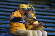 5 August 2018; Clare supporters Eileen Callinan, from Tulla, left, and and Mary O'Connell from Kilkee, read the match programme prior to the GAA Hurling All-Ireland Senior Championship semi-final replay match between Galway and Clare at Semple Stadium in Thurles, Co Tipperary. Photo by Diarmuid Greene/Sportsfile