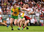 5 August 2018; Mattie Donnelly of Tyrone in action against Ciaran Thompson of Donegal during the GAA Football All-Ireland Senior Championship Quarter-Final Group 2 Phase 3 match between Tyrone and Donegal at MacCumhaill Park in Ballybofey, Co Donegal. Photo by Oliver McVeigh/Sportsfile