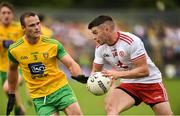 5 August 2018; Richard Donnelly of Tyrone in action against Neil McGee of Donegal during the GAA Football All-Ireland Senior Championship Quarter-Final Group 2 Phase 3 match between Tyrone and Donegal at MacCumhaill Park in Ballybofey, Co Donegal. Photo by Oliver McVeigh/Sportsfile