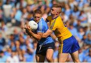 5 August 2018; Eoghan O'Gara of Dublin in action against Darra Pettit of Roscommon during the GAA Football All-Ireland Senior Championship Quarter-Final Group 2 Phase 3 match between Dublin and Roscommon at Croke Park in Dublin. Photo by Daire Brennan/Sportsfile
