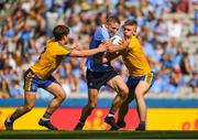 5 August 2018; Eoghan O'Gara of Dublin in action against David Murray, left, and Darra Pettit of Roscommon during the GAA Football All-Ireland Senior Championship Quarter-Final Group 2 Phase 3 match between Dublin and Roscommon at Croke Park in Dublin. Photo by Daire Brennan/Sportsfile