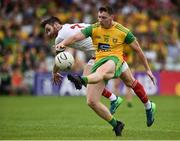 5 August 2018; Jamie Brennan of Donegal  in action against Ronan McNamee of Tyrone during the GAA Football All-Ireland Senior Championship Quarter-Final Group 2 Phase 3 match between Tyrone and Donegal at MacCumhaill Park in Ballybofey, Co Donegal. Photo by Oliver McVeigh/Sportsfile