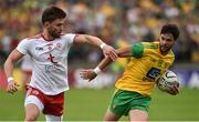 5 August 2018; Odhran MacNiallais of Donegal in action against Pádraig Hampsey of Tyrone during the GAA Football All-Ireland Senior Championship Quarter-Final Group 2 Phase 3 match between Tyrone and Donegal at MacCumhaill Park in Ballybofey, Co Donegal. Photo by Oliver McVeigh/Sportsfile