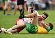 5 August 2018; Odhran MacNiallais of Donegal and Colm Cavanagh of Tyrone tussle during the GAA Football All-Ireland Senior Championship Quarter-Final Group 2 Phase 3 match between Tyrone and Donegal at MacCumhaill Park in Ballybofey, Co Donegal. Photo by Oliver McVeigh/Sportsfile