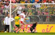 5 August 2018; Declan McClure of Tyrone shoots to score his side's second goal past Donegal goalkeeper Shaun Patton during the GAA Football All-Ireland Senior Championship Quarter-Final Group 2 Phase 3 match between Tyrone and Donegal at MacCumhaill Park in Ballybofey, Co Donegal. Photo by Stephen McCarthy/Sportsfile