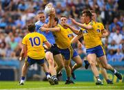 5 August 2018; Eoghan O'Gara of Dublin in action against Roscommon players, from left, Niall Kilroy, David Murray, and Niall McInerney during the GAA Football All-Ireland Senior Championship Quarter-Final Group 2 Phase 3 match between Dublin and Roscommon at Croke Park in Dublin. Photo by Piaras Ó Mídheach/Sportsfile