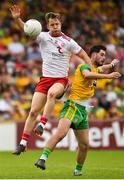 5 August 2018; Kieran McGeary of Tyrone in action against Ryan McHugh of Donegal during the GAA Football All-Ireland Senior Championship Quarter-Final Group 2 Phase 3 match between Tyrone and Donegal at MacCumhaill Park in Ballybofey, Co Donegal. Photo by Oliver McVeigh/Sportsfile