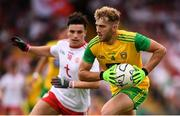 5 August 2018; Stephen McMenamin of Donegal and Lee Brennan of Tyrone during the GAA Football All-Ireland Senior Championship Quarter-Final Group 2 Phase 3 match between Tyrone and Donegal at MacCumhaill Park in Ballybofey, Co Donegal. Photo by Stephen McCarthy/Sportsfile