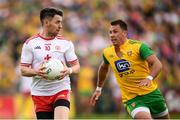 5 August 2018; Mattie Donnelly of Tyrone and Paul Brennan of Donegal during the GAA Football All-Ireland Senior Championship Quarter-Final Group 2 Phase 3 match between Tyrone and Donegal at MacCumhaill Park in Ballybofey, Co Donegal. Photo by Stephen McCarthy/Sportsfile