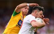 5 August 2018; Mattie Donnelly of Tyrone in action against Paul Brennan of Donegal during the GAA Football All-Ireland Senior Championship Quarter-Final Group 2 Phase 3 match between Tyrone and Donegal at MacCumhaill Park in Ballybofey, Co Donegal. Photo by Stephen McCarthy/Sportsfile