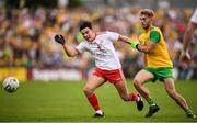 5 August 2018; Lee Brennan of Tyrone and Stephen McMenamin of Donegal during the GAA Football All-Ireland Senior Championship Quarter-Final Group 2 Phase 3 match between Tyrone and Donegal at MacCumhaill Park in Ballybofey, Co Donegal. Photo by Stephen McCarthy/Sportsfile