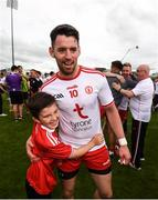 5 August 2018; Mattie Donnelly of Tyrone is congratulated by a young supporter following the GAA Football All-Ireland Senior Championship Quarter-Final Group 2 Phase 3 match between Tyrone and Donegal at MacCumhaill Park in Ballybofey, Co Donegal. Photo by Stephen McCarthy/Sportsfile