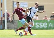 6 August 2018; Stephen Folan of Dundalk in action against Chris Hull of Cobh Ramblers during the EA Sports Cup semi-final match between Cobh Ramblers and Dundalk at St. Colman's Park in Cobh, Co. Cork. Photo by Ben McShane/Sportsfile