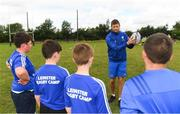 8 August 2018; Leinster player Ross Byrne with participants during the Bank of Ireland Leinster Rugby Summer Camp at Westmanstown RFC in Clonsilla, Dublin. Photo by Piaras Ó Mídheach/Sportsfile