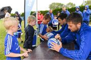 8 August 2018; Leinster players Ross Byrne, front, and Max Deegan with participants during the Bank of Ireland Leinster Rugby Summer Camp at Westmanstown RFC in Clonsilla, Dublin. Photo by Piaras Ó Mídheach/Sportsfile