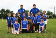 8 August 2018; Leinster players Ross Byrne and Max Deegan with participants during the Bank of Ireland Leinster Rugby Summer Camp at Westmanstown RFC in Clonsilla, Dublin. Photo by Piaras Ó Mídheach/Sportsfile