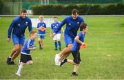 8 August 2018; Leinster players Ross Byrne, left, and Max Deegan with participants during the Bank of Ireland Leinster Rugby Summer Camp at Westmanstown RFC in Clonsilla, Dublin. Photo by Piaras Ó Mídheach/Sportsfile