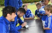 8 August 2018; Leinster player Max Deegan, left, and Ross Byrne with participants during the Bank of Ireland Leinster Rugby Summer Camp at Westmanstown RFC in Clonsilla, Dublin. Photo by Piaras Ó Mídheach/Sportsfile