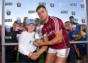 8 August 2018; Fintan Burke of Galway receives the Man of the match award from Jamie Noone, aged 10, from Killimordaly, Co. Galway, following the Bord Gais Energy GAA Hurling All-Ireland U21 Championship Semi-Final match between Galway and Tipperary at the Gaelic Grounds in Limerick. Photo by Diarmuid Greene/Sportsfile