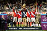 10 August 2018; President Michael D Higgins presents the Agha Khan Cup to the Mexico team, from left, Eugenio Garza Perez, Enrique Gonzalez, Chef d'Equipe Stanny van Paesschen, Patricio Pasquel following the Longines FEI Jumping Nations Cup of Ireland during the StenaLine Dublin Horse Show at the RDS Arena in Dublin. Photo by Matt Browne/Sportsfile