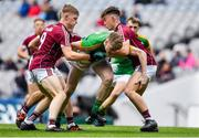 11 August 2018; Matthew Costello of Meath in action against Galway players, from left, Conor Raftery, Cathal Sweeney and Seán Black during the Electric Ireland GAA Football All-Ireland Minor Championship semi-final match between Galway and Meath at Croke Park in Dublin. Photo by Brendan Moran/Sportsfile