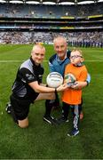 11 August 2018; GAA legend and former Dublin goalkeeper John O'Leary who walked onto the pitch with his son Tom, age 7, who presented the ball to the referee Barry Cassidy, on behalf of the Jack & Jill Children's Foundation at Croke Park in Dublin. Tom, who has a very rare condition, has been supported by Jack & Jill home nursing care and John is a board member and ambassador for the charity. Photo by Ray McManus/Sportsfile